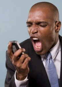black-man-yelling-into-cell-phone